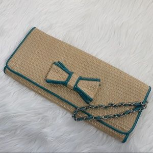BUENO STRAW CLUTCH WITH TURQUOISE TRIM ACCENT BOW